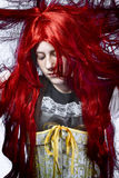 Redhaired girl in a poetic representation Stock Photo