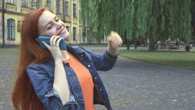 Girl talking on phone smiling and laughing stock footage