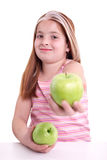 Redhaired  girl with two green apple,on white background Royalty Free Stock Photos