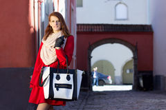 Redhaired girl walking in old town Royalty Free Stock Photo