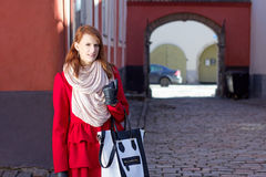 Redhaired girl walking in old town of Tallinn Stock Photography