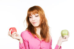 Redhaired Girl With Two Apples Stock Images