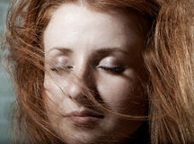 Redhaired mysterious woman Stock Photos