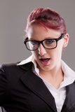 Redhaired sexy eighties secretary with glasses Stock Images