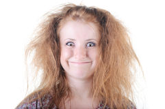 Redhaired uncombed freak woman . Isolated over white Royalty Free Stock Photography