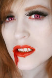Redhaired vampire. Portrait of red hair woman vampire Royalty Free Stock Photos