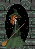 Redhaired Witch and Brickwall. This background was created with the idea of this witch walking into another world. A whole opening up in a brickwall. The royalty free illustration