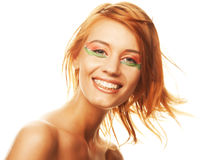 Redhaired woman. Happy smiling redhaired woman with creative makeup Royalty Free Stock Images