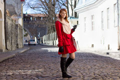 Redhaired woman walking in medieval european town Royalty Free Stock Photography