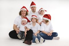 Redhats. Happy family celebrate Christmas together Royalty Free Stock Images