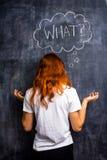 Redhead γυναίκα που ρωτά τι Στοκ Φωτογραφίες