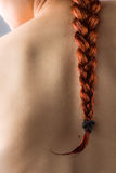 Redhead πλεξούδα γυναικών ` s Στοκ Φωτογραφίες
