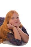 redhead мечтая девушки стоковое фото