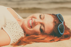 Redhead adult woman lying on beach Royalty Free Stock Photography