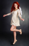 Redhead angel Stock Images