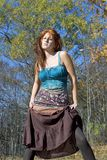 Redhead with attitude. Wearing a tank top and skirt Stock Photos