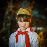 Redhead attractive boy dressed like soviet pioneer with red tie Stock Photography