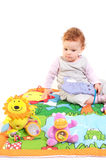 Redhead baby playing Stock Image