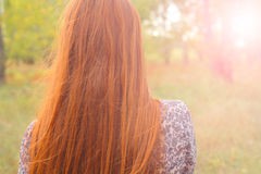 Redhead from back backlit Royalty Free Stock Photos