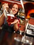 Redhead barmaid Stock Images