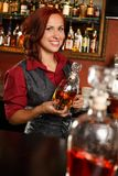 Redhead barmaid Stock Photography