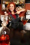 Redhead barmaid Stock Photo