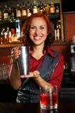 Redhead barmaid Stock Image