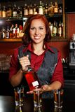 Redhead barmaid Stock Photo