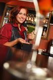 Redhead barmaid Royalty Free Stock Image