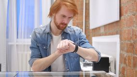 Redhead Beard Man Using Smartwatch for Browsing Email and Messages. 4k , high quality stock footage