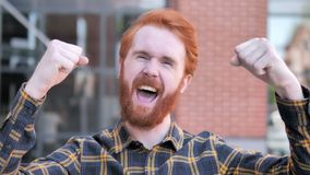 Redhead beard young man celebrating success outdoor stock video footage