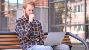 Redhead Beard Young Man Coughing while Working on Laptop Outdoor. 4k high quality, 4k high quality stock video