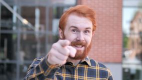 Redhead Beard Young Man Pointing with Finger Outdoor. 4k high quality, 4k high quality stock video