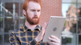 Redhead Beard Young Man Using Tablet Outdoor. 4k high quality, 4k high quality stock video