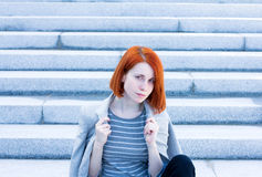 Redhead beautiful businesswoman with a jacket sitting on t Stock Photos