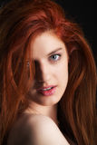 Redhead. A beauty shot of a young woman with red hair Stock Photo