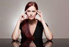 Redhead beauty with strong facial expression. Royalty Free Stock Photography