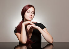 Redhead beauty with strong facial expression. Stock Photography