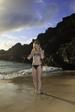 Redhead in a bikini at the beach Royalty Free Stock Photo