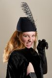 Redhead in black hat pretending to snarl Royalty Free Stock Photography