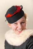 Redhead in black and red hat with fur Royalty Free Stock Photography