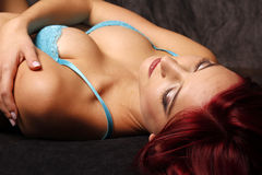 Redhead in blue bra Royalty Free Stock Image