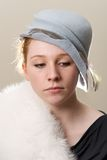 Redhead in blue hat and white fur Royalty Free Stock Image