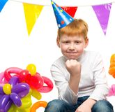 Redhead boy among balloons Royalty Free Stock Images