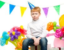 Redhead boy among balloons Royalty Free Stock Photos