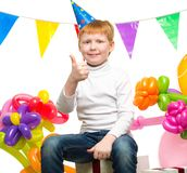 Redhead boy among balloons Stock Photos
