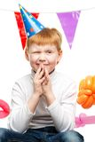 Redhead boy in birthday hat Stock Photos