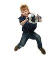 Redhead boy with soccer ball Royalty Free Stock Photo