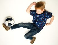 Redhead boy with soccer ball Royalty Free Stock Images
