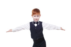 Redhead boy in a vest with bow tie, portrait isolated Royalty Free Stock Image